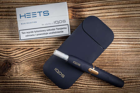 KATOWICE, POLAND - February 27, 2020: Heating tobacco system IQOS. IQOS Philip Morris tobacco product technologies.