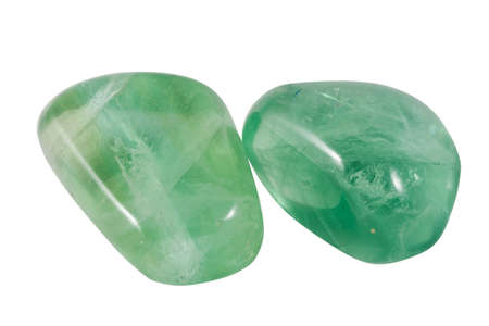 fluorite: two green fluorite gems isolated on white with mesh texture in reflections Stock Photo