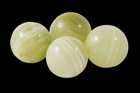 sumptuousness: greenish onyx balls isolated on black