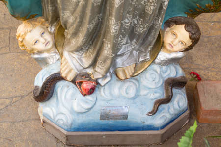 Footing of Jesus Christ statue with angels and a snake with Edem 스톡 콘텐츠