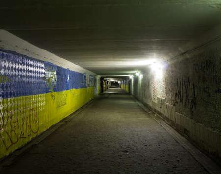 Chernihiv, Ukraine - 10/15/2015: Old underground crossing painted in patriotic colors of ukrainian flag