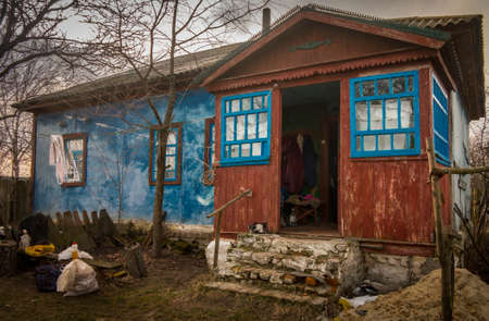 Abandoned village house with cracked paint in Ukraine