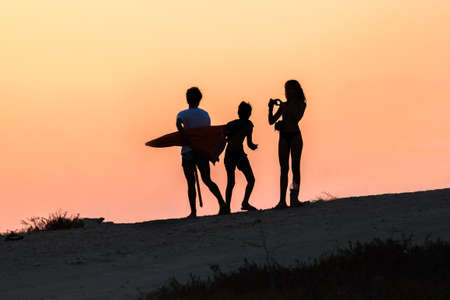 silhouette of children taking pictures photo