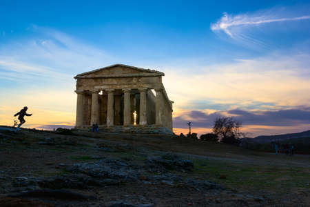 Temple of Concord at evening with a little tourist running Imagens