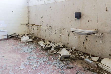 Abandoned bathroom with broken washbasins Stock Photo