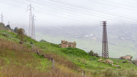 Stone hovel and eletricy pylons