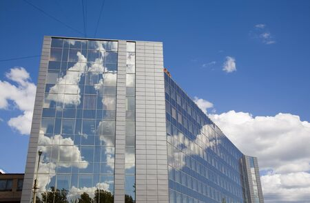 the sky mirrored in a modern glass house, Saint-Petersburg