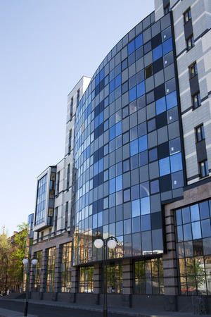 modern huge glass building in saint-petersburg in summer