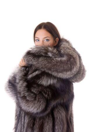 Portrait of the beautiful girl in a fur coat