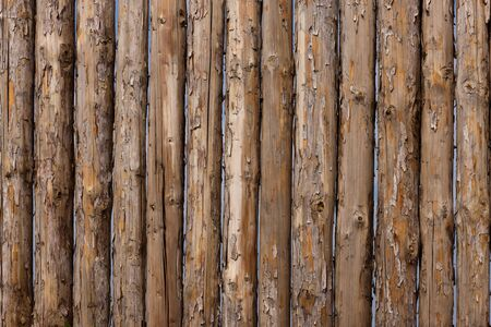 Traditional wooden rural wall from old logs