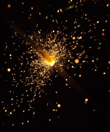 Bright burning fireworks in night close up