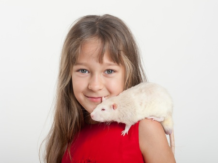 portrait of the girl with a white domestic rat Stock Photo - 15019209
