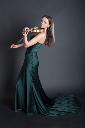 portrait of the violinist in an evening dress 写真素材