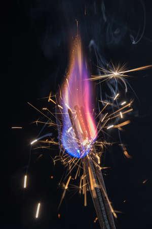 bright burning sparklers closeup on black background photo