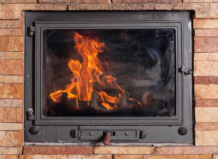 The Fire Behind A Closed Glass Door Stock Photo Picture And Royalty