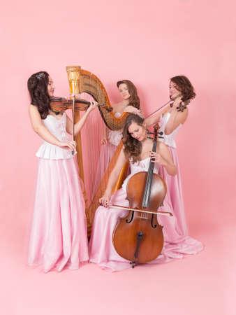 Portrait of a string quartet on a pink background