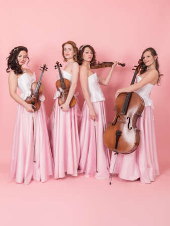 studio portrait of a string quartet in concert costumes