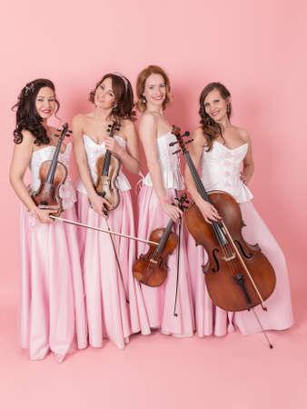 studio portrait of a string quartet in concert costumes