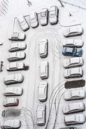 parking under the first snow, top view