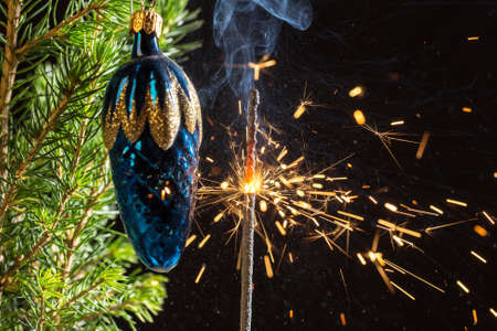 holiday sparks and spruce branches with a toy