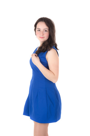 teenage girl in a blue dress on a white background