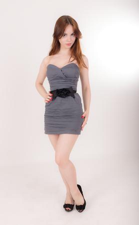 portrait of a slim girl in a gray dress Stockfoto