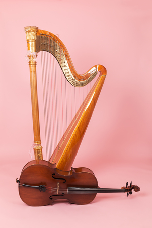 harp and cello on a pink background