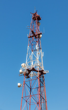 communication tower on a background of clean blue sky