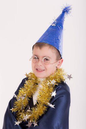 studio portrait of a boy in wizard clothes