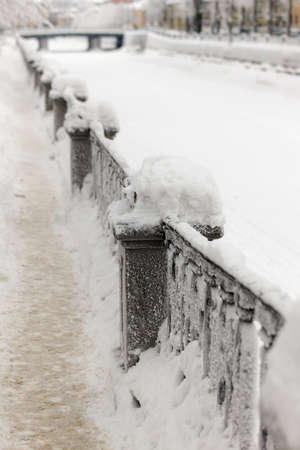 embankment fence on a cold winter day