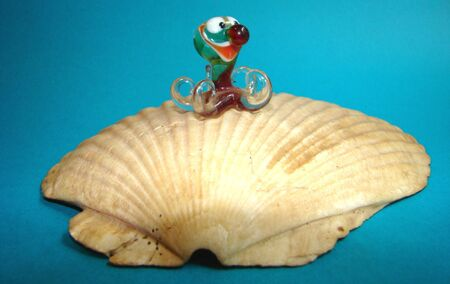 the far east: Toy glass octopus on pearls on a bowl of a Far East comb