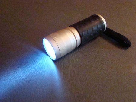 The light-emitting diode manual lantern burning in darkness