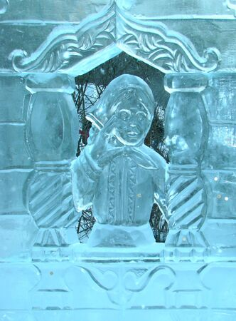 The girl in a window, the character of Russian national fairy tale Alyonushka. An ice sculpture Stock Photo
