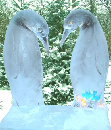 sculpture of two penguins from ice in winter park. Moscow Stock Photo