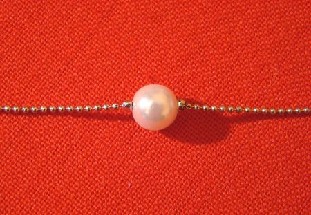 chainlet: pearl on a chainlet on a red background Stock Photo