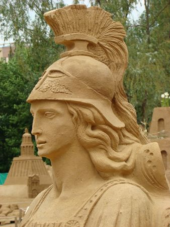 Sand figure of Athena in Ancient Greek mythology of the goddess of the organised war and the wisdom, one of the most esteemed goddesses of the Ancient Greece. The exhibition passes in the Botanical garden of the Moscow state                                photo