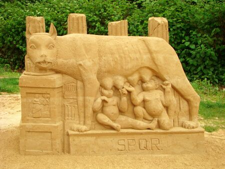 founders: Sculpture from sand. The Roman she-wolf, raising milk of two babies � Romula and Rema, legendary founders of Rome