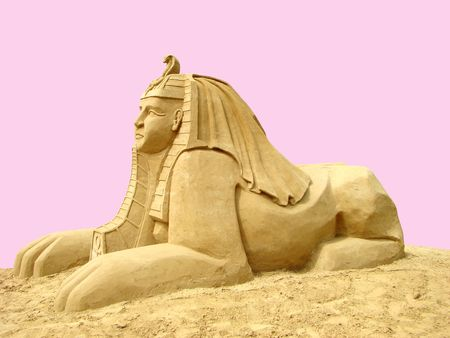 Statue sphinx from sand. In Ancient Egypt sphinx — with a head of a man and a body of a lion