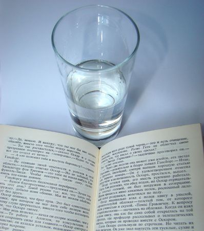 transparent glass with water at the exposed book