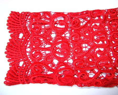 sleeve of red lace blouse on a white background Stock Photo