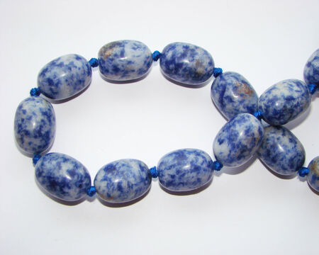 ultramarine: beads of lapis lazuli  blue gemstone Stock Photo