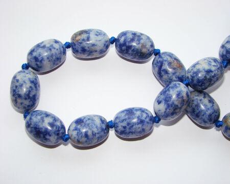 lapis: beads of lapis lazuli  blue gemstone Stock Photo