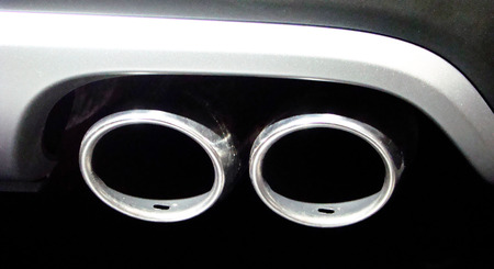 Double exhaust pipe on the car coming out of the muffler  Double exhaust pipe on the car coming out of the muffler  photo