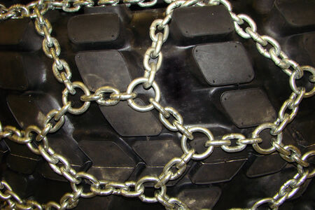 lugs:  tread pattern - terrain, with powerful cleats with metal chain