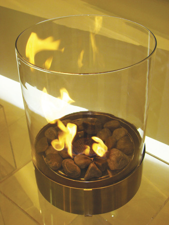 Bio Fireplace glass and metal with fire photo