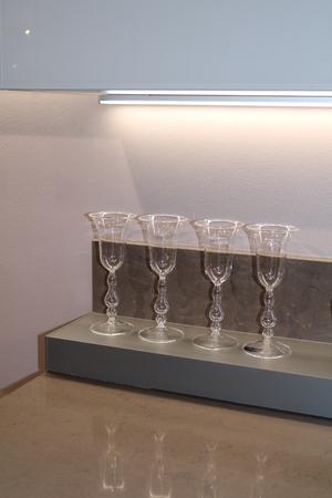 Glass wine glasses on the kitchen shelf Stock Photo