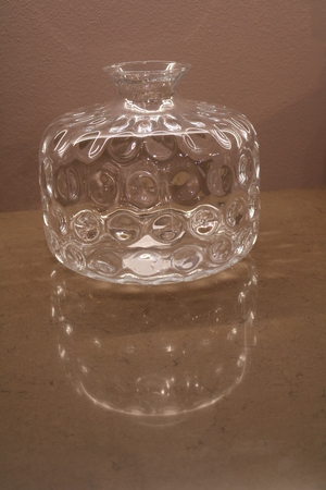 Glass decanter on a marble table