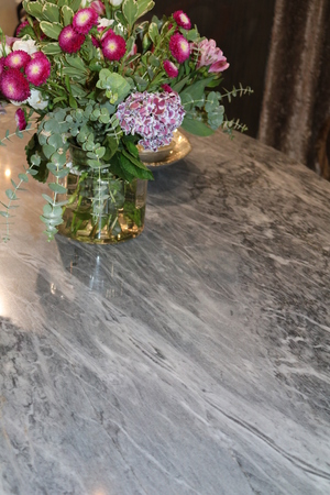 Marble table with a vase of flowers