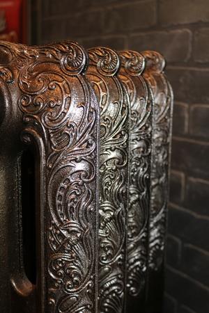 Cast iron radiators, reproduced from originals of past centuries Stock Photo