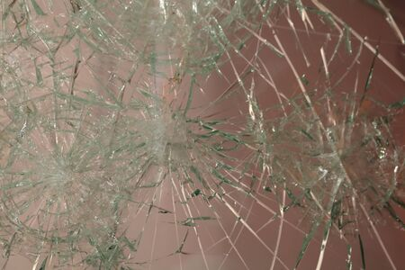looting: The surface of the broken glass in the window Stock Photo